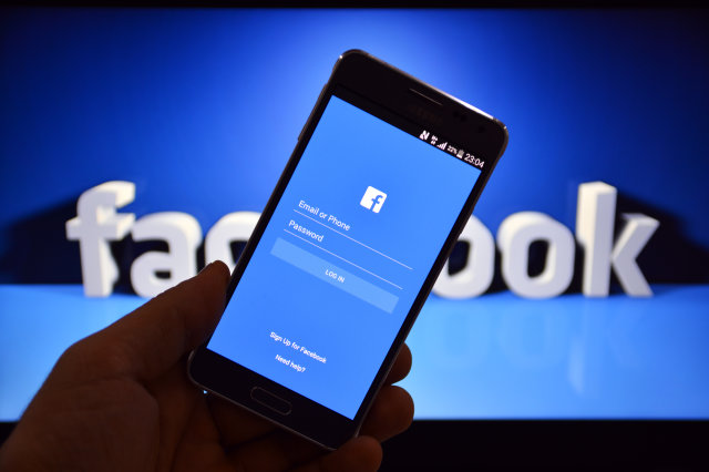 facebook login screen in mobile with blue background
